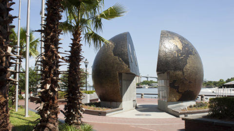 "The ""A World Apart"" monument on River Street. The two halves of the globe are split, representing the conflict of a world divided."